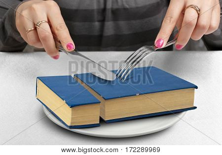 education creative concept cut book on plate