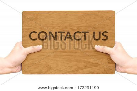 Two Hand Holding Dark Brown Wood Signboard With Contact Us Word Isolated On White Background,busines