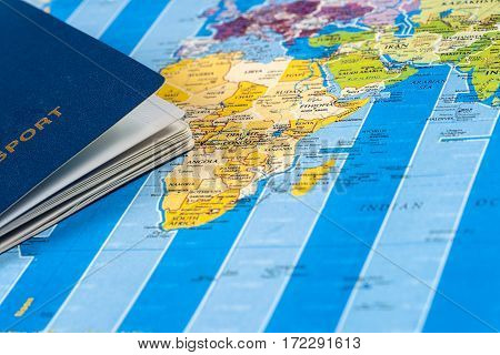 Travel - concept. Traveler's pasport touristic maps on the white desk. Travel background. Tourist essentials. Space for text