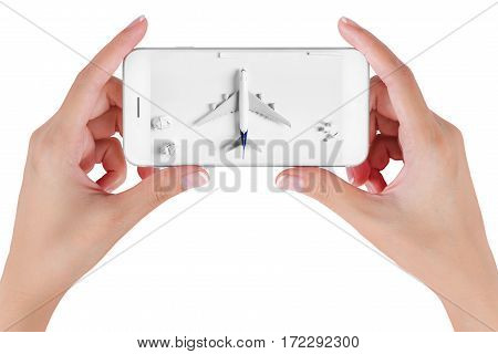 Woman hand using smart phone searching Preparation and to do list traveling with blank paper noted paper ball airplane push pin. Travel concepts Isolated on white background.