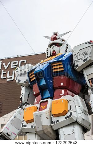 Tokyo Japan - April 8 2016: Full size Gundam RX78 Performances at DiverCity Tokyo Plaza Odaiba Tokyo Japan - It is 18m tall The sculpture of famous anime franchise robot.