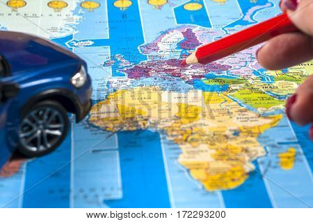 Travel - concept. Traveler's accessories touristic maps female hands. Travel background. Car journey planning. Tourist essentials. Space for text