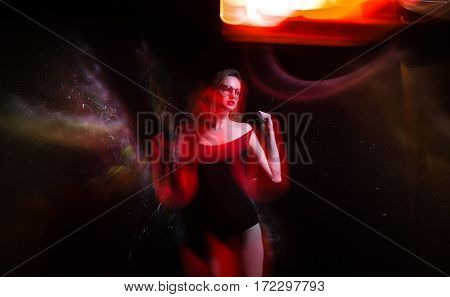 Beautiful Girl In Black Bathing Suit And Round Glasses Isolated Black Cosmos Background. Space Conce