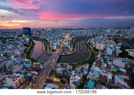 HO CHI MINH CITY, VIETNAM - OCTOBER 17, 2015: Aerial sunset view of houses and Business and Administrative Center of Ho Chi Minh city on NHIEU LOC canal