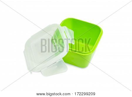 Green reusable plastic food storage container for home use with open translucent cover on a light background