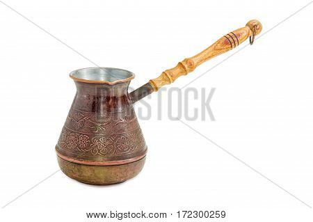 Old copper coffee pot with a wooden handle on a light background