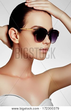 Fashion Sunglasses. Sexy Woman In Swimsuit With Golden Sunglasses And Natural Makeup. Glamour Shot O
