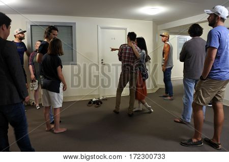 AUCKLAND - FEB 11 2017:People stand in line to view a apartment for rent. Demand for rental properties in Auckland is so high that some people are offering well over the asking rate to secure a house.