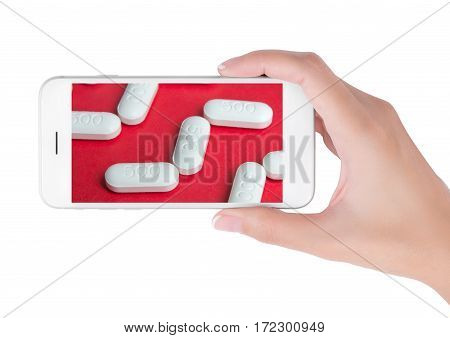 Woman using her smart phone searching medicine information white pills on red background. in health care and medicine concept Isolated on white background.