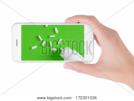 Woman using her smart phone searching medicine information white pills and Blank Medicine bottle pouring on green background. in health care and medicine concept Isolated on white background.