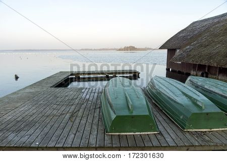 Boat dock at the lake with boat house