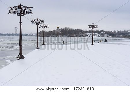 Winter landscape on a Dnepr river embankment in center of Dnepr city Ukraine