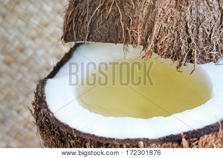 An Open Coconut Palm Fruit With Coconut Oil In It