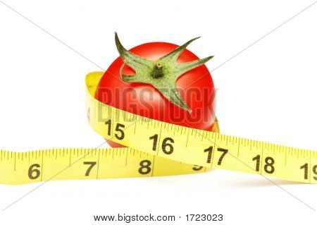 Tomato And Measuring Tape Illustrating Dieting Concept