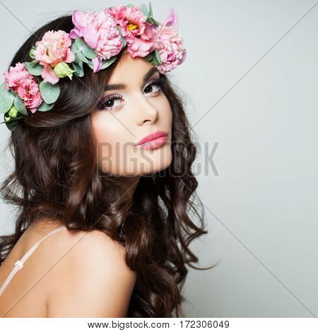 Perfect Woman Fashion Model with Healthy Skin and Flowers Wreath. Spring Beauty