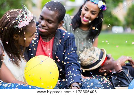 Indian girl and african couple celebrating together on street party