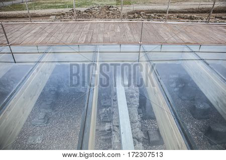 Protective glass floor at Roman site of Caparra Crossroad ancient city ruins at Silver Route Via de la Plata Caceres Spain