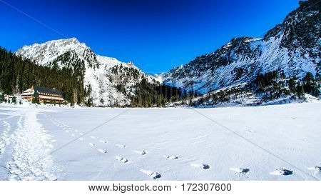 Snowy frozen lake Popradske pleso in winter High Tatras mountains Slovakia