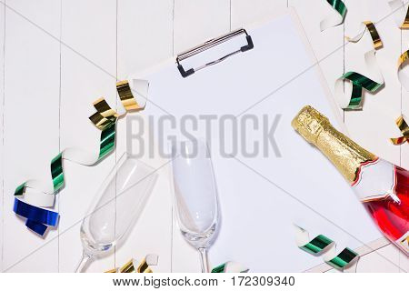 Celebration Flat Lay. Champagne Bottle With Copyspace On Wooden Background