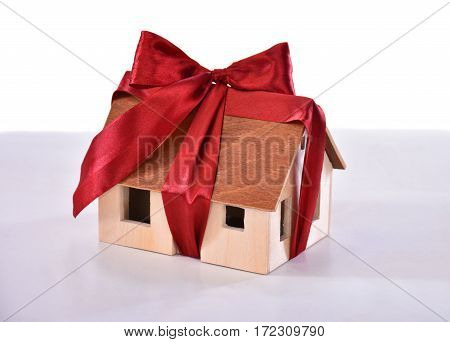 Small Model Of A Wooden House Tied With A Bow