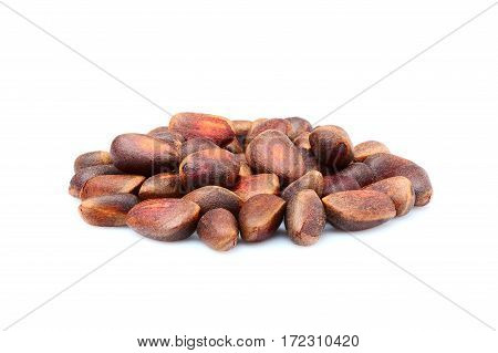 Pine nuts in shell isolated on white background.