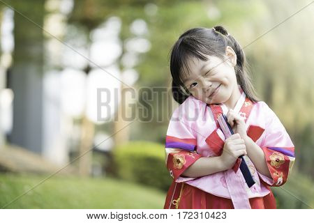 Korean child wearing a Traditional Hanbok in the park