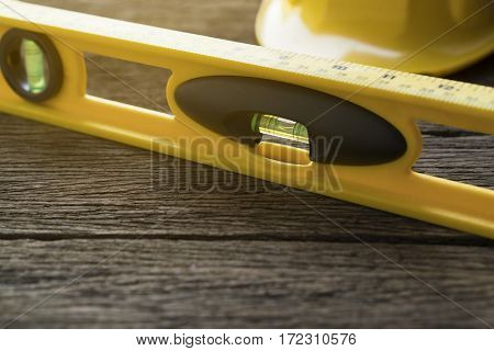 Yellow building levels on old wood table