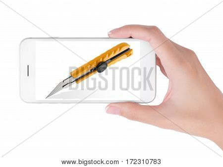 Woman using smart phone searching Box cutter knife cuting and office supplies concept isolated white background.