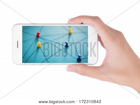 Woman using smart phone searching small network of colorful push pins linked together by string on blue background. Network and connections concept isolated on white background.