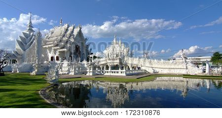 Unseen Thailand (Wat Rong Khun) panorama in the daytime sky