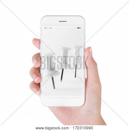 Woman using smart phone searching close up white push pin object and office supplies concept isolated on white background.