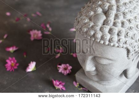 buddha head with stones , flowers and tabular