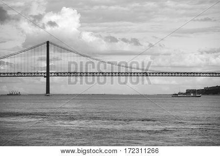 The 25 de Abril Bridge (25th of April Bridge) is a suspension bridge connecting the city of Lisbon capital of Portugal to the municipality of Almada on the left (south) bank of the Tagus river