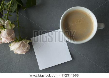Light pink chineese rose with coffe and sticker on grey concrete background