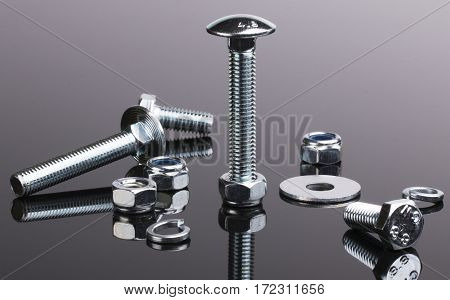 Set of bolts with washers and nuts