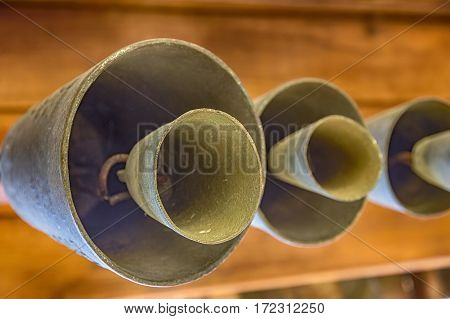 Set of hanging cow/sheep bells art view. Wooden background