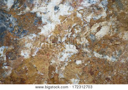 Stone. Background on the surface of a rock cliff.