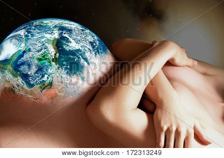 Pregnant woman with belly in the form of a planet on a background of outer space. Elements of this image furnished by NASA.