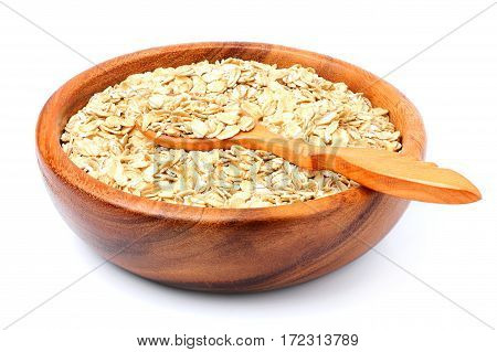 Oat flakes in a wooden bowl with spoon isolated on white background.