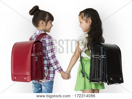 Girl and her friend are going to school