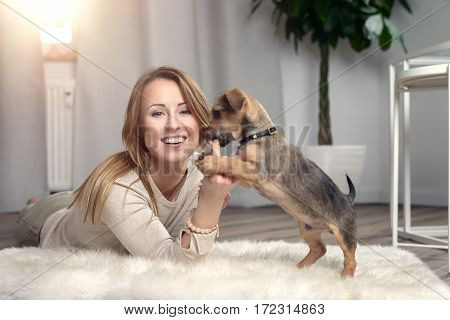 Attractive Friendly Woman Cuddling With Her Dog