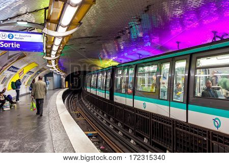 PARIS, FRANCE - MAY 25, 2016: Train on platform on parisian metro station - rapid transit system opened in 1900, has 16 lines, 303 stations and it is the second busiest subway in Europe.
