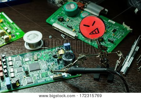 Electrical Circuit Board under a magnify glass with smile