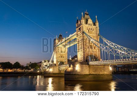 A dusk view over the River Thames London with the iconic landmark Tower Bridge dominating the scene.