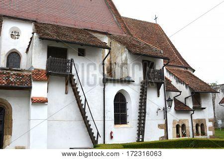 Courtyard of the medieval fortified saxon church Harman-Honigberg, Transylvania, Romania.