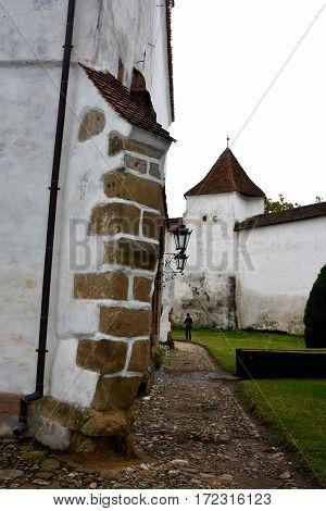 Courtyard of the old medieval fortified saxon church Harman-Honigberg, Transylvania, Romania