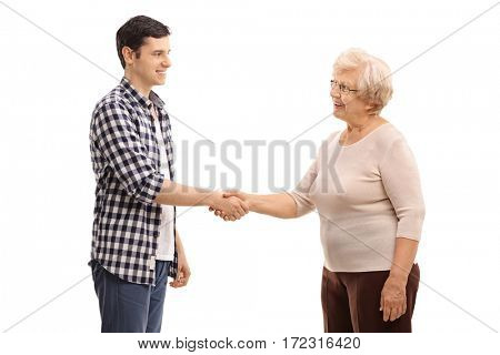 Young man shaking hands with an elderly woman isolated on white background