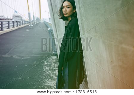Asian ethnicity on a bridge in a shoot.