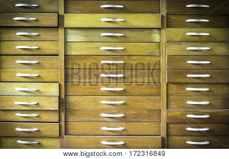 Old vintage wooden chest of drawers background