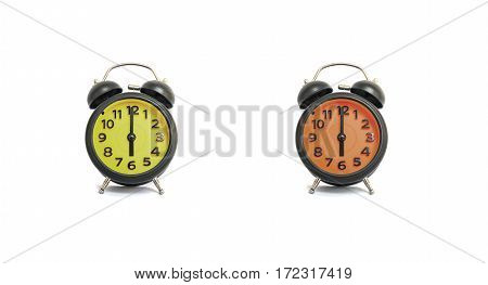 Closeup yellow alarm clock and orange alarm clock for decorate in 6 o'clock isolated on white background